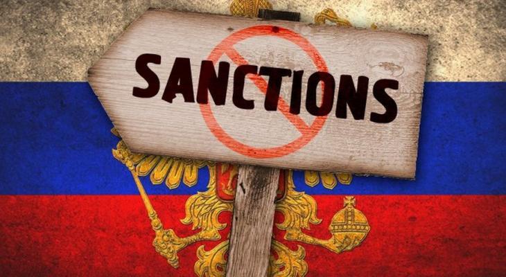 Санкции на российском гербе